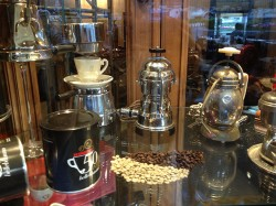 Kimbo coffee and part of the front window display of coffeemakers at Gran Caffè La Caffettiera