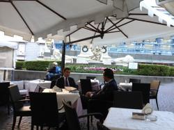 Businessmen doing deals in the Gran Caffè La Caffettiera plaza