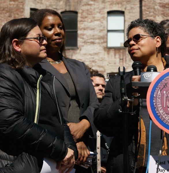 "At the Day of Remembrance ceremony, Mildred Guy, a displaced tenant from the former 119 Second Ave., spoke about the apartment her family used to call ""Mommy's Home,"" as from left, Councilmember Rosie Mendez and Public Advocate Letitia James listened.  Photo by Patrick J. Eves"