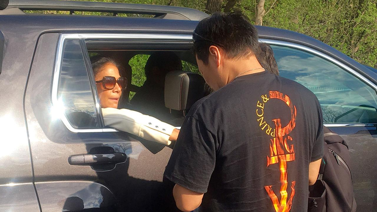 Musician Sheila E. consoles a fan as she leaves Paisley Park following a private ceremony to remember Prince.