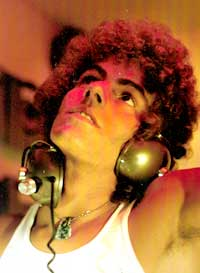 Steve Thompson DJing with headphones and red lights 1973-1974