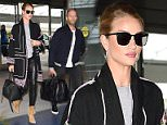 Rosie Huntington and Jason Statham arrive at JFK airport in NYC.  Ref: SPL1273893  030516   Picture by: Ron Asadorian / Splash News  Splash News and Pictures Los Angeles: 310-821-2666 New York: 212-619-2666 London: 870-934-2666 photodesk@splashnews.com