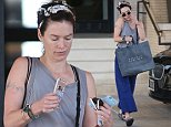 *EXCLUSIVE* Beverly Hills, CA - Lena Headey, known for her role on the HBO hit Game of Thrones, was spotted doing a little retail therapy at Barney's New York. She was comfy and casual while heading to her car after the shopping trip. She was wearing a headband in her hair, white rimmed sunglasses, grey tank, and blue trousers with slippers. She layered up on the bracelets and spiced the plain outfit up.\n  \nAKM-GSI      May 3, 2016\nTo License These Photos, Please Contact :\nSteve Ginsburg\n(310) 505-8447\n(323) 423-9397\nsteve@akmgsi.com\nsales@akmgsi.com\nor\nMaria Buda\n(917) 242-1505\nmbuda@akmgsi.com\nginsburgspalyinc@gmail.com