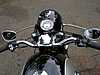 Photo showing front bars and instruments including speedometer and tacometer on our 1965 R60 BMW Motorcycle.