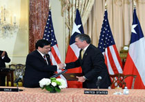 Photo of R. Gil Kerlikowske and the Chilean Ambassador at the Chile CMAA signing ceremony