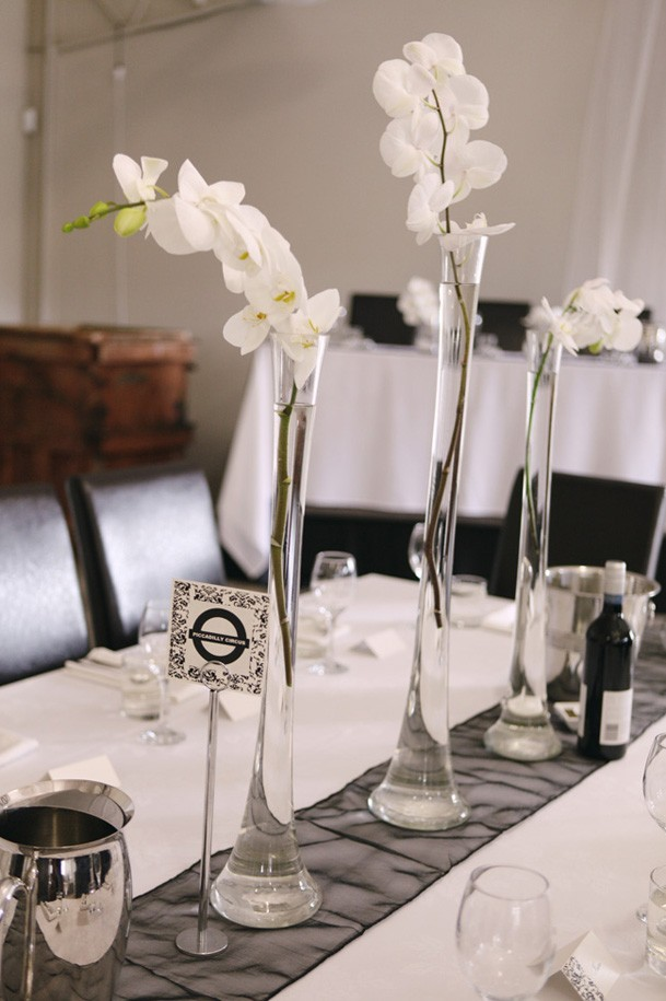 Classic Black and White Inspiration from New Zealand - 32 tall clear flute vases white orchid centerpiece