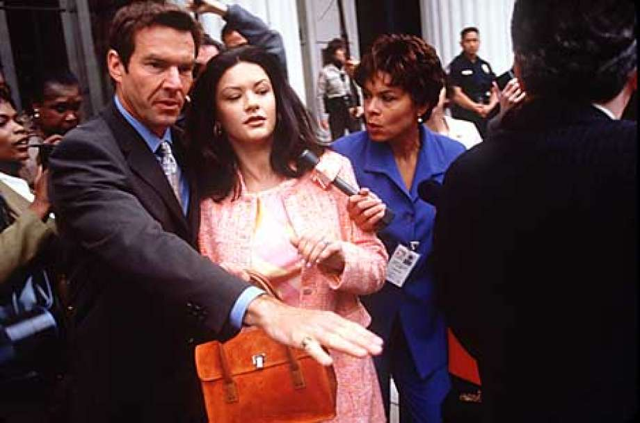 Catherine Zeta-Jones, with her attorney (Dennis Quaid), is a drug lord's wife trying to keep her husband out of jail. Publicity photo