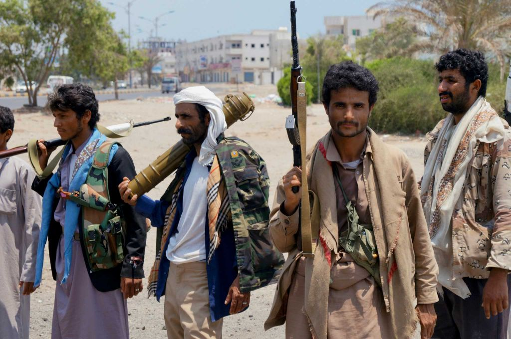 Shiite fighters known as Houthi gather at a street in Aden, Yemen, Thursday, April 2, 2016. Yemen's Shiite rebels and their allies fought their way through the commercial center of Aden on Thursday and seized the presidential palace on a strategic hilltop in this southern coastal city, security officials said. (AP Photo/Wael Qubady)