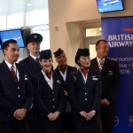 British Airways cabin crew members gather at the gate ahead of the airline's first departure from San Jose Mineta Airport.