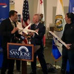 International Airlines Group CEO Willie Walsh presents San Jose Mayor Sam Liccardo with a gift from British Airways: a model Boeing 787-9 Dreamliner airplane.