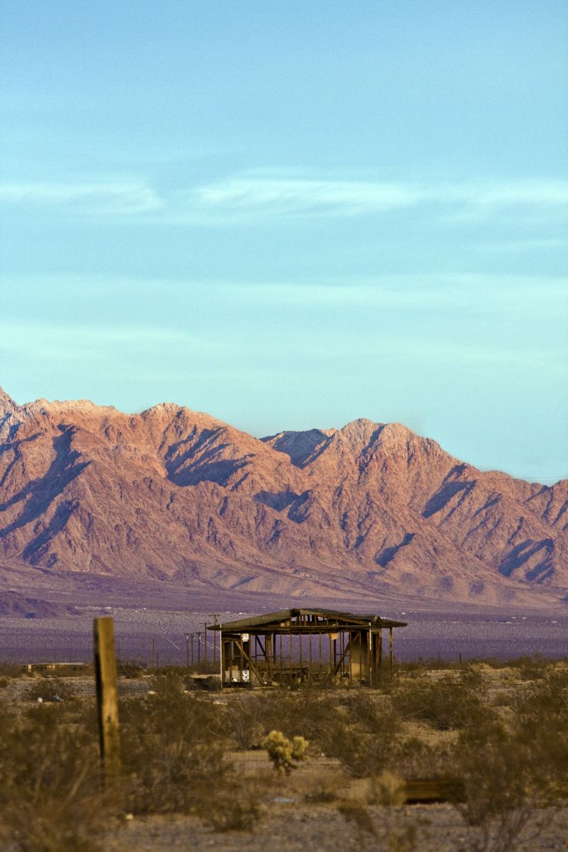 Dilapidated Cabin with the Sheephole Mountains as the backdrop. Photo by Preston Drake-Hillyard