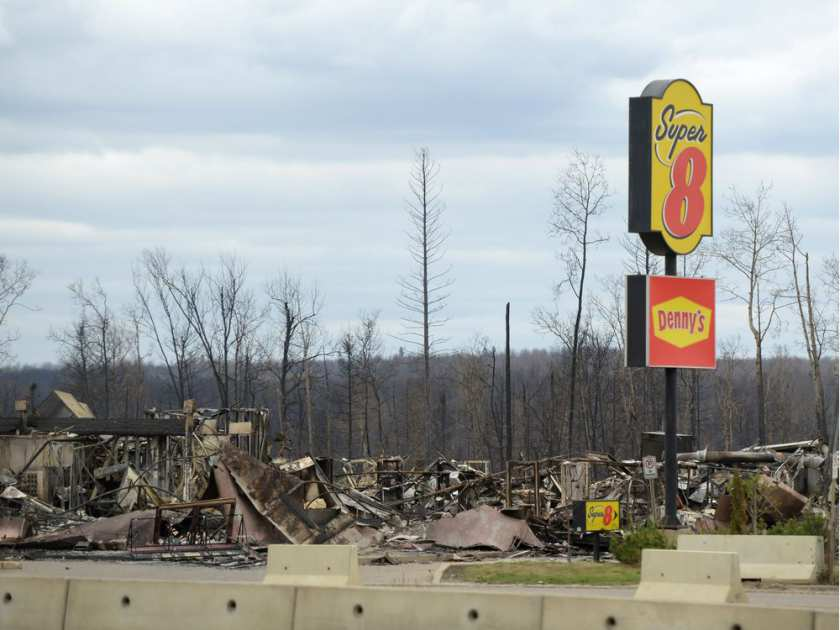 A view of the burned out Super 8 motel is shown during a media tour of the fire-damaged city of Fort McMurray, Alta. on Monday, May 9, 2016.