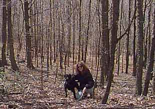 Jen Weir and Sadie in woods at Carlton Hill