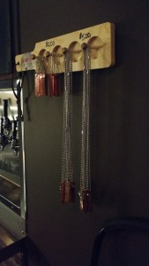 TagaBrew copper tags hanging from the wall at Farmington Brewing Company