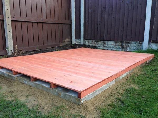 Timber shed floor on flagged base