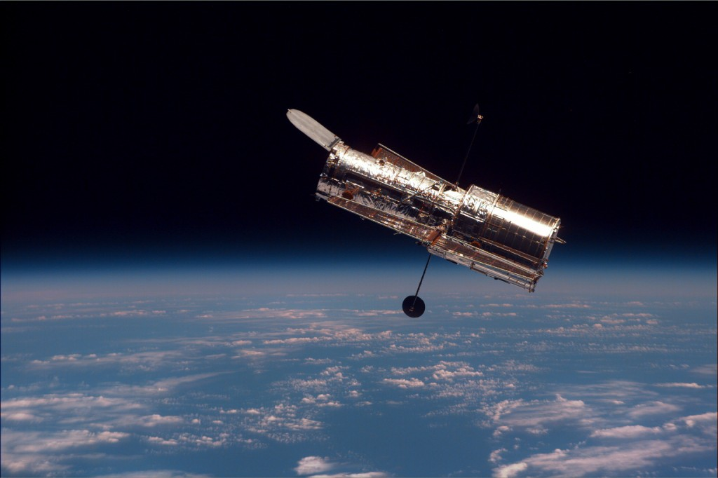 Hubble as seen from Discovery during its second servicing mission