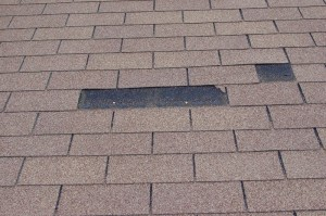 High winds can blow off shingles like in this photo.