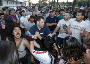 Protestors surround a Trump supporter on S. Almaden Blvd. outside San Jose Convention Center as Presidential candidate Donald Trump holds a rally in San