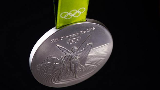 Accompanying these pieces of precious metal, of course, is the ribbon, which is made up of 50% recycled polyester polyethylene terephthalate (PET) material.