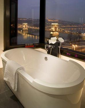 Hotel room and bathroom with view in Sofitel Budapest Luxury Hotel in Hungary
