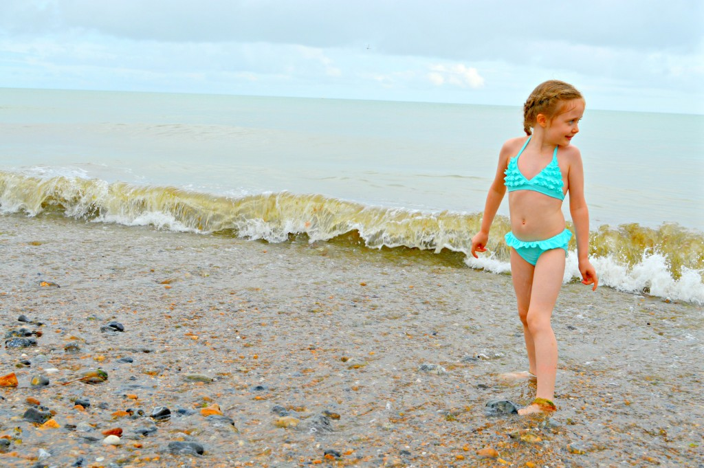 children in bikini, little girl, bikini, beach, imeverymum, parent blogger, style, fashion, Monsoon, turquoise, beach, sea, waves