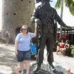 "Me with Blackbeard—he really was larger than life! Behind me is the remains of the ""castle""."