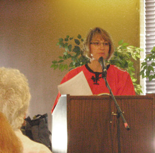 An image of Danné, the owner of Dandilion Wellness Centre, speaking at this event.
