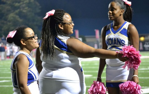 Special needs students participate with football cheerleaders
