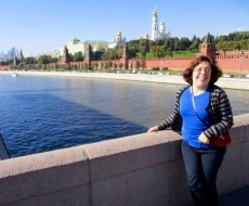 Deanne on a bridge with Kremlin in the background.