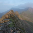 First light on the Crib Goch ridge, with Garnedd Ugain and Snowdon behind.