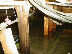 Flooded crawlspace with water damage service