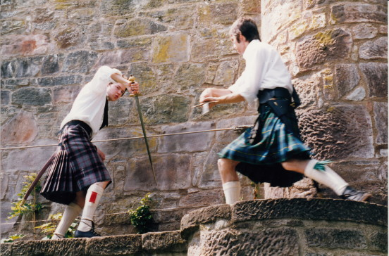 boys with their swords, a castle and some kilts