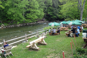 Sipping a cold frosty pint alongside the river at Long Trail's Brew Pub.