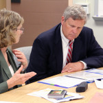Agriculture Secretary Tom Vilsack visits listens to  Dr. Lois Wright Morton, professor, Department of Sociology, Iowa State University, about recent surveys on producers' opinions of climate change and its impact on agriculture at the U.S. Department of Agricultue (USDA), National Centers for Animal Health in Ames, IA, on Friday, June 6, 2014. USDA photo by Darin Leach.