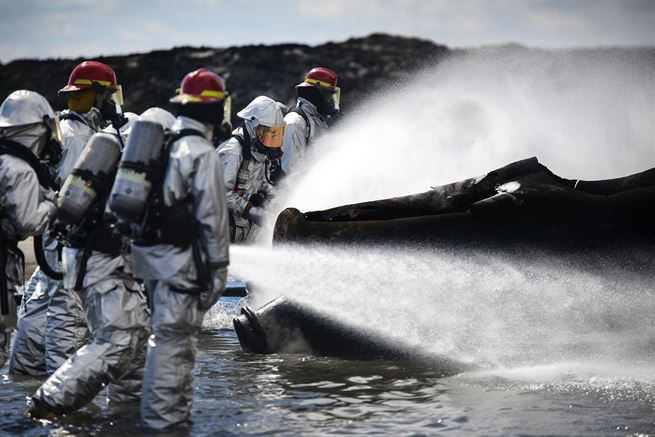 Marines use fire hoses to extinguish a blaze during firefighting training to sharpen their skills at Marine Corps Air Station Iwakuni, Japan, March 11, 2016. Marine Corps photo by Lance Cpl. Jacob A. Farbo