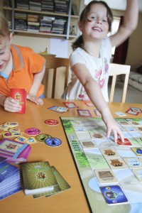 Children playing Robot Turtles. Image courtesy ThinkFun.