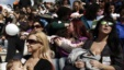 FILE - Women breastfeed babies during a mass event in Athens, Nov. 2, 2014.
