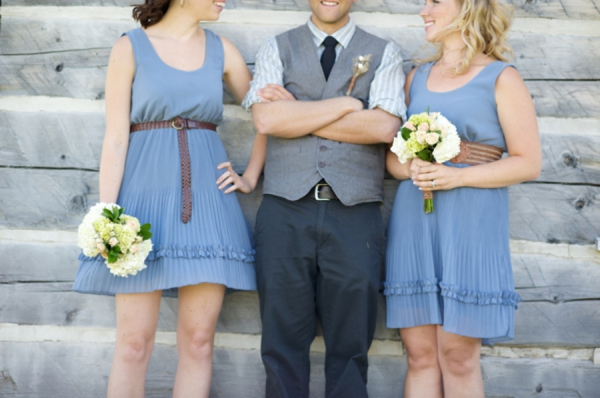 groomsmen in vests, periwinkle blue bridesmaids dresses with leather belt accents, rustic wedding fashion