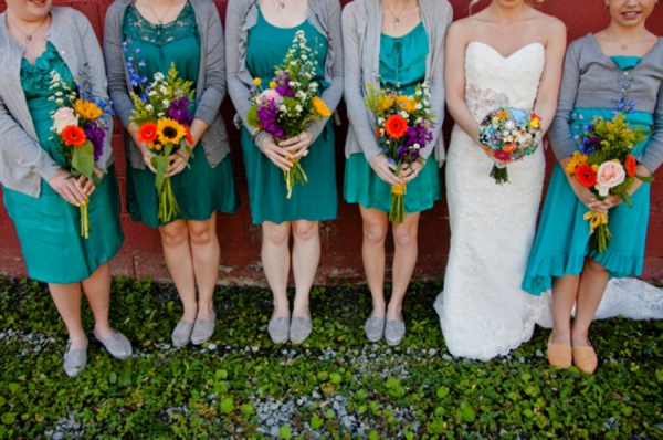 teal bridesmaid dresses with gray cardigan cover ups, bright wildflower bouquets, bridesmaids in TOMS, rustic wedding fashion