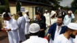 Muslim worshipers walk out after the friday prayer at the Yahya Mosque, in Saint-Etienne-du-Rouvray, Normandy, France, July 29, 2016. Four days after the hostage taking in Saint-Etienne-du-Rouvray, officials and worshipers of the Muslim community  paid tribute to priest Jacques Hamel and Christian community.