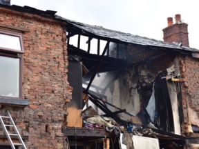 A blast ripped through the terraced house in Ashton-under-Lyne. Pic: Greater Manchester Fire and Rescue Service
