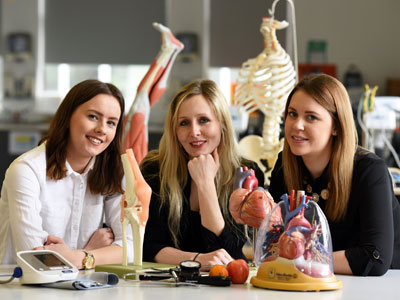 Dr Laura Brown, Senior Lecturer in Nutrition, Food and Health Sciences, pictured centre, with BSc (Hons) Food and Nutrition students Rebecca Bligh and Zoe Johnston . Link to Help to keep students healthy.