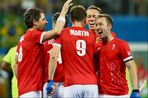 Harry Martin celebrates with his team mates after scoring Great Britain's fourth goal