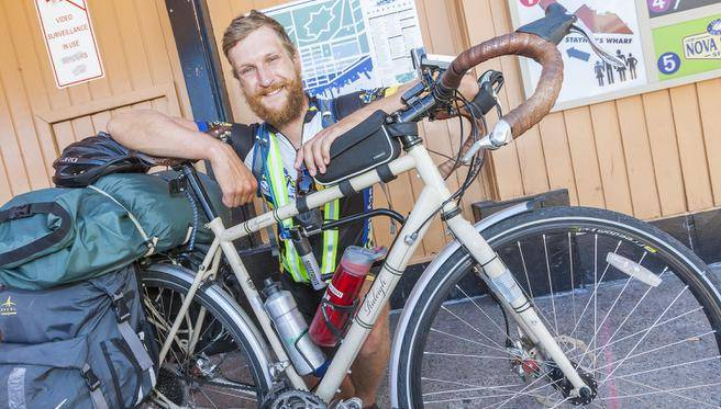 Martin Bauman is on a cross-country biking journey to raise awareness about mental health. (STAFF)