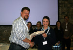 Dr Axel Posluschny presenting a conference pack a Balla Secondary School student. Image: Philippa Barry 2013
