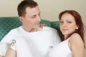 picture of a confident couple sitting on sofa