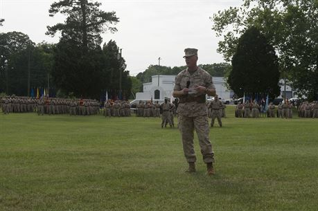 U.S. Marine Col. James M. Bright, outgoing regimental commanding officer of the Marine Corps Security Force, addresses the guests of a change-of-command ceremony June 19 at Naval Weapons Station Yorktown, Va. The Marine Corps Security Force Regiment is the Marine Corps' largest regiment with over 4,000 Marines and sailors spread across the globe.