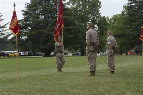 U.S. Marine Col. James W. Evans (left) and U.S. Marine Col. James M. Bright await the change of colors during the change-of-command ceremony June 19 at Naval Weapons Station Yorktown, Va. The exchanging of regimental colors represents the passing of command from the outgoing commanding officer to the incoming commanding officer.