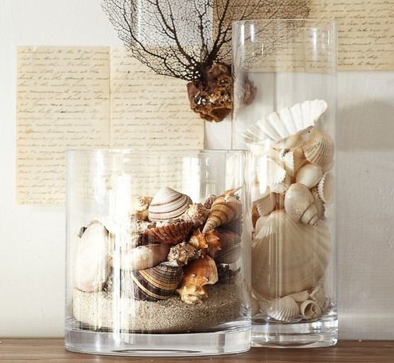 vases filled with sand and shells