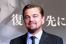 American actor Leonardo DiCaprio hits the top led of the sake barrel for good luck during the Japan premiere of The Revenant